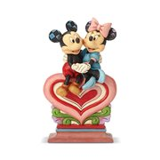 Disney Traditions Mickey and Minnie Sitting on Heart Statue