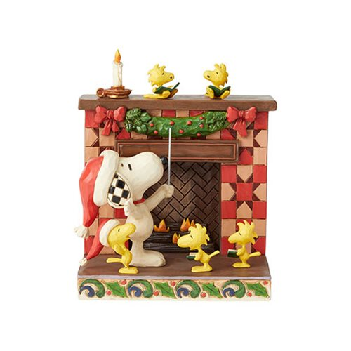 Peanuts_Snoopy_at_Fireplace_Fireside_Carols_by_Jim_Shore_Statue