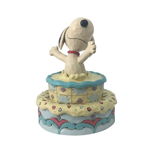 Peanuts_Snoopy_Jumping_Out_Birthday_Cake_Surprise_by_Jim_Shore_Statue