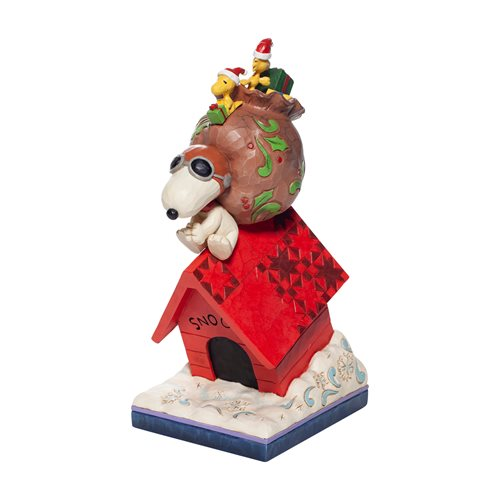 Peanuts Snoopy Delivering Gifts Delivering Cheer Statue by Jim Shore