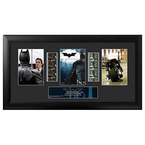 Own a piece of the movie! Beautifully mounted and framed! A must-have collectible! This amazing film cell features a print and an actual strip of film from the film, The Dark Knight . Measures 11-inches tall x 20-inches wide. Perfect for displaying in your home or at the office, all the elements are framed in black wood and includes a certificate of authenticity. Gotham City is under siege once again and it's time for Bruce Wayne (Christian Bale) to put on his bat-costume and do battle with two evil enemies: The Joker (Heath Ledger) and district-attorney-turned-villain Two-Face (Aaron Eckhart). NOTE: The actual strips of film vary from piece to piece as they are hand picked from reels of film.